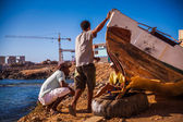 Workers repair a boat — Stock Photo