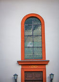 Old leaded glass arched window — Stock Photo