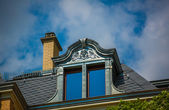 Ornate stone dormer window — Stock Photo