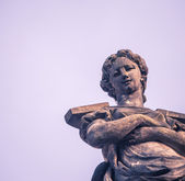 Female statue on a gable — Stock Photo