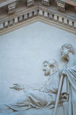 Two statues in a gable — Stock Photo