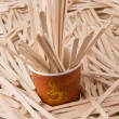 Wooden stirrers and paper coffee cup — Stok fotoğraf #46084385