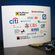 Bank Logos on the White Paper and three Darts — Stock Photo