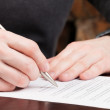 Business men reading contract. - Stock Photo