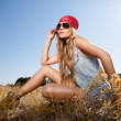 Sensual blond girl in field — Stock Photo