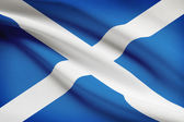 Series of ruffled flags. Scotland. — Stock Photo