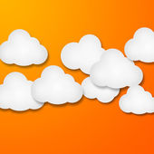 White paper clouds over gradient orange color background — Foto Stock