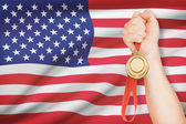 Medal in hand with flag on background - United States of America — Stock Photo