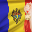 Medal in hand with flag on background - Republic of Moldova — Stock Photo