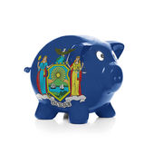 Piggy bank with flag coating over it - State of New York — Stock Photo