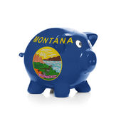 Piggy bank with flag coating over it - State of Montana — Stock Photo