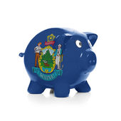Piggy bank with flag coating over it - State of Maine — Stock Photo
