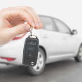 Male holding car keys with remote control system - 1 to 1 ratio — Stock Photo