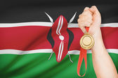 Medal in hand with flag on background - Republic of Kenya — Foto Stock