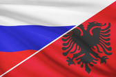 Series of ruffled flags. Russia and Albania. — Stock Photo