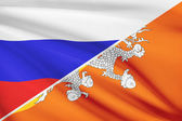 Series of ruffled flags. Russia and Bhutan. — Stock fotografie