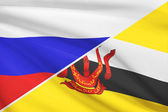 Series of ruffled flags. Russia and Brunei. — Stockfoto