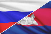Series of ruffled flags. Russia and Cambodia. — Stock Photo