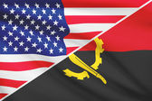 Series of ruffled flags. USA and Angola. — Stock Photo