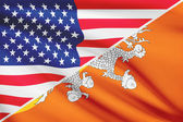 Series of ruffled flags. USA and Bhutan. — Stock Photo