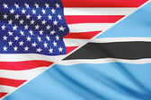 Series of ruffled flags. USA and Botswana. — Stock Photo