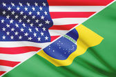 Series of ruffled flags. USA and Brazil. — Stockfoto