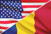 Series of ruffled flags. USA and Chad. — Stockfoto