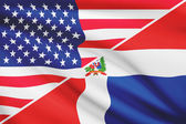 Series of ruffled flags. USA and Dominican Republic. — Foto Stock