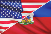 Series of ruffled flags. USA and Republic of Haiti. — Stock Photo