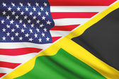 Series of ruffled flags. USA and Commonwealth of Jamaica. — Stock Photo