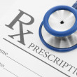 Stethoscope over blank medical prescription form - studio shot — Stock Photo #45203331