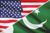 Series of ruffled flags. USA and Islamic Republic of Pakistan. — Stock Photo