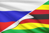 Series of ruffled flags. Russia and Republic of Zimbabwe. — Stock Photo