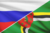 Series of ruffled flags. Russia and Commonwealth of Dominica. — Stock Photo