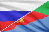 Series of ruffled flags. Russia and State of Eritrea. — Stock Photo