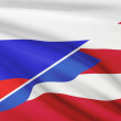 Series of ruffled flags. Russia and Commonwealth of Puerto Rico. — Stock Photo