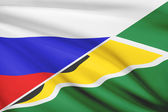 Series of ruffled flags. Russia and Co-operative Republic of Guyana. — Stock Photo