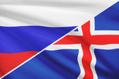 Series of ruffled flags. Russia and Iceland. — Stock Photo