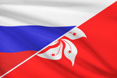 Series of ruffled flags. Russia and Hong Kong Special Administrative Region of the People's Republic of China. — Stock Photo