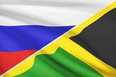 Series of ruffled flags. Russia and Commonwealth of Jamaica. — Stock Photo