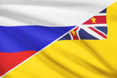 Series of ruffled flags. Russia and Niue. — Stock Photo