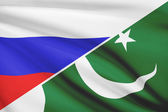 Series of ruffled flags. Russia and Islamic Republic of Pakistan. — Stock Photo