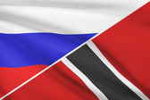 Series of ruffled flags. Russia and Trinidad and Tobago. — Stock Photo