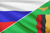 Series of ruffled flags. Russia and Republic of Zambia. — Stock Photo