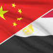 Series of ruffled flags. China and Arab Republic of Egypt. — Stock Photo #46717381