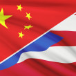 Series of ruffled flags. China and Commonwealth of Puerto Rico. — Stock Photo