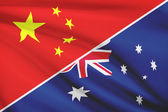Series of ruffled flags. China and Commonwealth of Australia. — Stock Photo