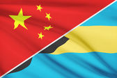 Series of ruffled flags. China and Commonwealth of the Bahamas. — Stock Photo