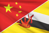 Series of ruffled flags. China and Nation of Brunei, Abode of Peace. — Stock Photo