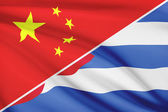 Series of ruffled flags. China and Republic of Cuba. — Stock Photo